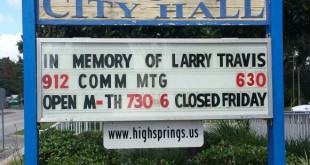 The sign in front of City Hall in High Springs Thursday paid tribute to its former mayor and longtime member of the community, Larry Travis. Travis died Tuesday at 72 after a battle with cancer.