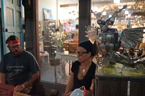 Jody Schaible (left) sits next to his wife, Elaine, while his art sits on display at downtown Ocala's First Friday Artwalk.