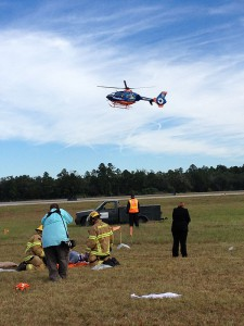 Gainesville Fire Rescue responds to an injured passenger in a mock crash. The emergency drill is performed every three years, and Santa Fe students are incorporated.