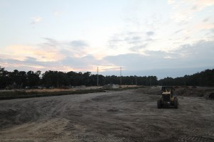 NP International is overseeing the planning and construction southwest of the university's former landfill site, where Hull Road is being extended (above) to provide a connection between SW 34th Street and Village Point, its new development.