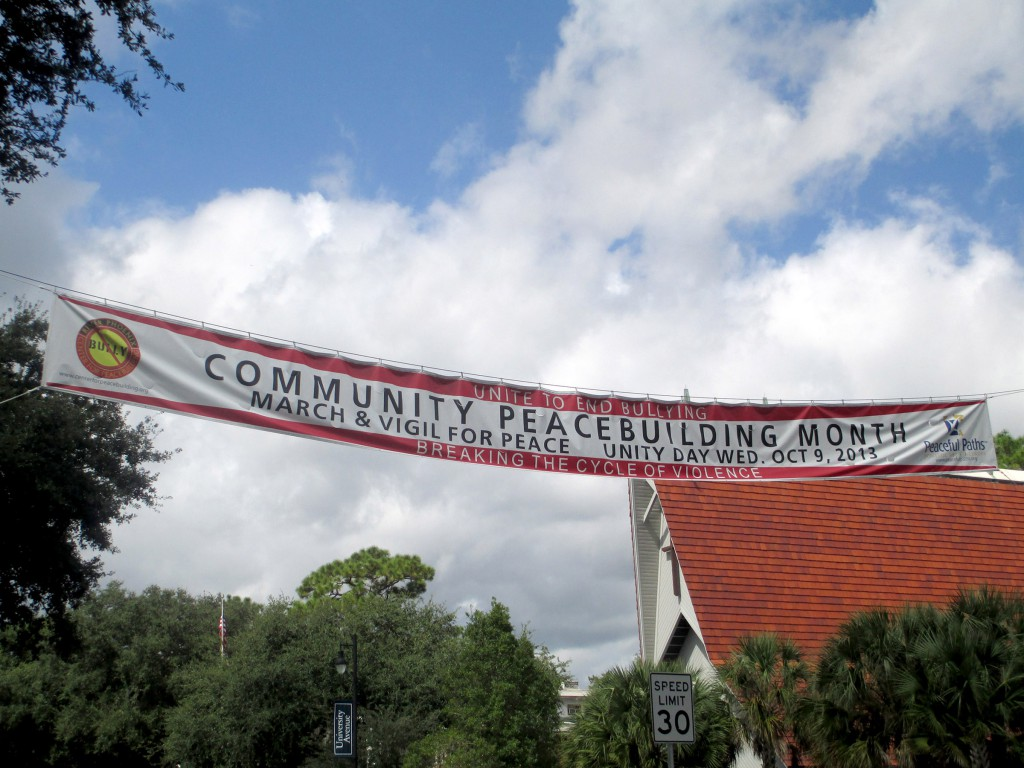 This banner for Peacebuilding Month hangs across University Ave. on NW 17th St.