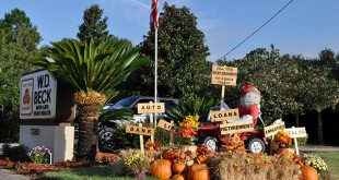 W.D. Beck, the State Farm insurance agency in Keystone Heights, already has its scarecrow, W.D., setup in front of its building for the Scarecrow Strut. Themed as an insurance customer, W.D. is driving a red jeep surrounded by signs that name State Farm's services.