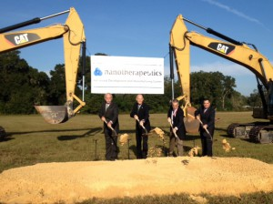 Gov. Rick Scott, second from the left, broke ground on the Nanotherapeutics facility along with Alachua Mayor Gib Coerper and Nanotherapeutics President and CEO Dr. James Talton.