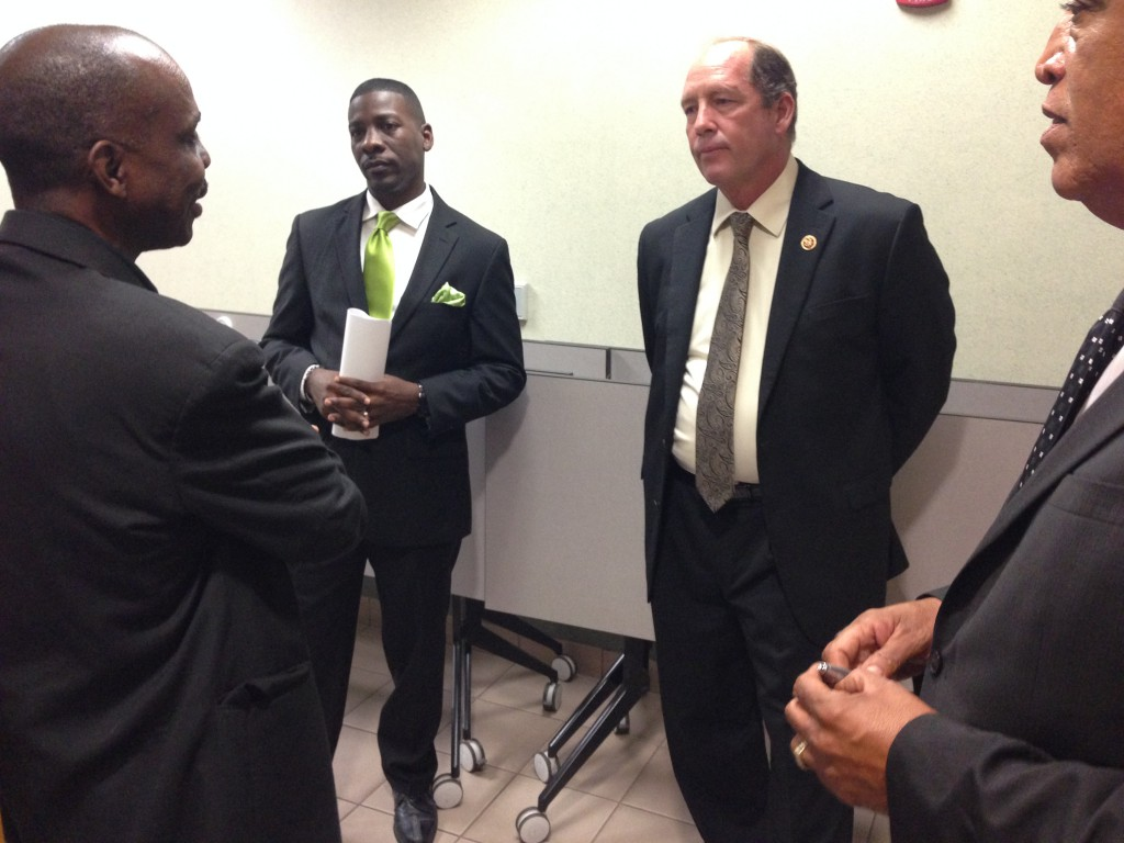 Congressman Ted Yoho speaks to members of the African American Accountability Alliance before the town hall meeting to discuss his political actions while in office.