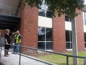 Barzella Papa, the president and CEO of the Community Foundation of North Central Florida, and Vince Smith, the superintendent for CPPI, discussing the yet-to-be-constructed entrance for the new facility.
