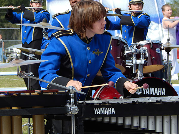 """Aidan Childers, 15-year-old freshman, contributes to the NHS Band of Pride's """"As Light as a Feather"""" show as a member of the percussion."""