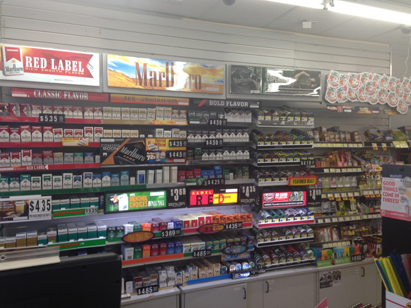 The wall of cigarettes behind the counter at a Kangaroo Express convenient store in Gainesville contains about 10 different brands of cigarettes. Manager Amanda Holmes said Marlboro brand cigarettes are the most popular.