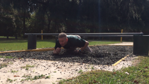 Deputy Tussey demonstrates a part of Marion County Sheriff's Office's new obstacle course. Each deputy must run the course to assess their individual fitness.