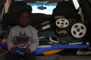 Three-year-old David waits patiently as his mom, Regina Jackson, purchases new child safety seats during Gainesville Fire Rescue's monthly car seat inspection.
