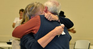 Incumbent Sue Weller hugs her husband, Tom Weller, Tuesday night after finding out she won the majority of the vote High Springs city commissioner.