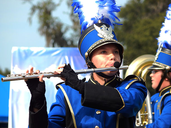 """Sarah Bleasdale, 17-year-old senior in the NHS Band of Pride plays the flute during the """"As Light as a Feather"""" show on Nov. 9."""