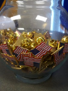 Inside the Veteran's Success Center, next to a group of flags representing each branch of the military, a bowl of flag pins is available for any veteran who would like one.