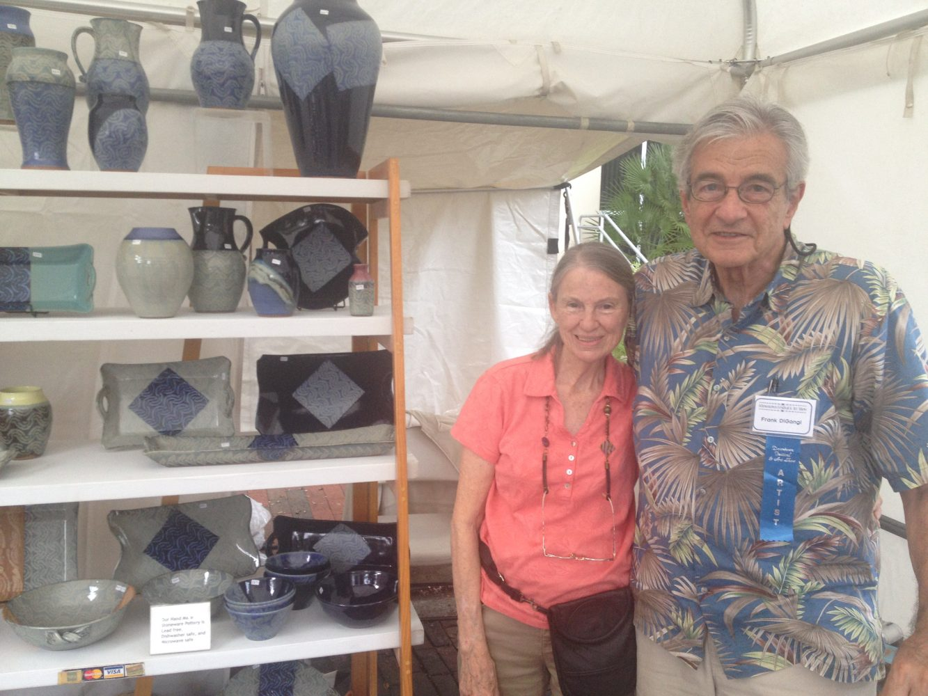 Artist Frank DiGangi poses with his wife and his pottery.