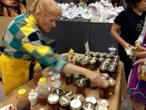 Nancy Gentry selling her honey at the Craft Festival at the O'Connel Center.