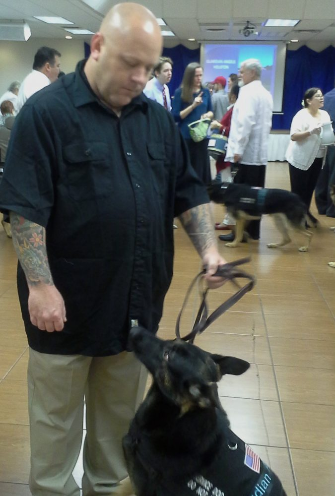 Brian Duelz and his service dog Remy