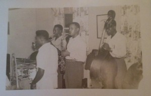 The High Notes practiced two to three times a week in one of the band member's home. This photo was taken in 1957 while performing at a local fraternity house. (Band members from left to right) Vocalist James Henry, 27, Marion McClellan, 30, Richard McClellan, 27, Hampton McClellan, 24.