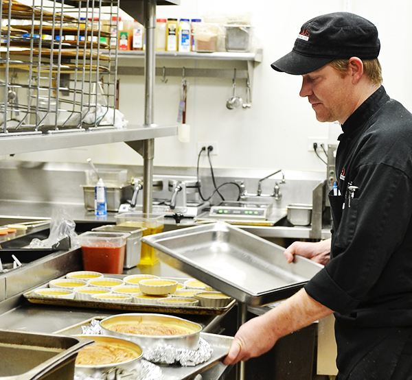 Executive chef Charles Hahn prepares fresh cheesecakes and creme brulee for the diners at Vellos Brickstreet Grill.