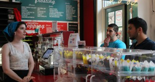 Stephanie Browning, 26, helps David Amen, 23, and Jamal Kazbour, 21, pick out cupcakes at Sarkara Sweets on January 16, 2014. Sarkara Sweets recently started selling cupcakes online to cater to customers across the nation.