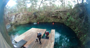 Divers exit Blue Grotto Dive resort after a dive
