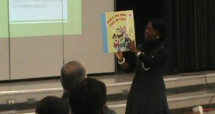 Kandra Albury performing a mock reading for Alachua County Public Schools Head Start program faculty at Prairie View Elementary School on Friday.