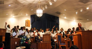 The Rev. Joy Gallmon stands at the pulpit while the Lake Weir High School choir sings a gospel hymn at New St. John Baptist Church in Ocala, Fla. Sunday night. Gallmon was asked to speak at the church by the Dr. Martin Luther King, Jr. Commemorative Commission Committee of Ocala.