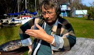 Helen Ciallella sits outside B's Marina in Yankeetown, Fla., on Monday, January 13. Ciallella runs the marina.