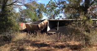 Railroad cars spill their cargo onto the ground in Dunnellon. Marion County fire rescue teams were called to the scene after the accident early Friday morning.
