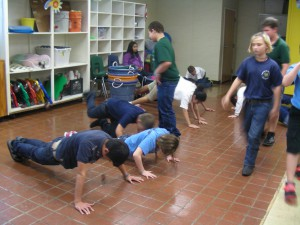 Students from Highland City Elementary School do push-ups before returning to another physical activity. Polk County public school students will receive report cards assessing their health and fitness this term.  Photo by Karen White.