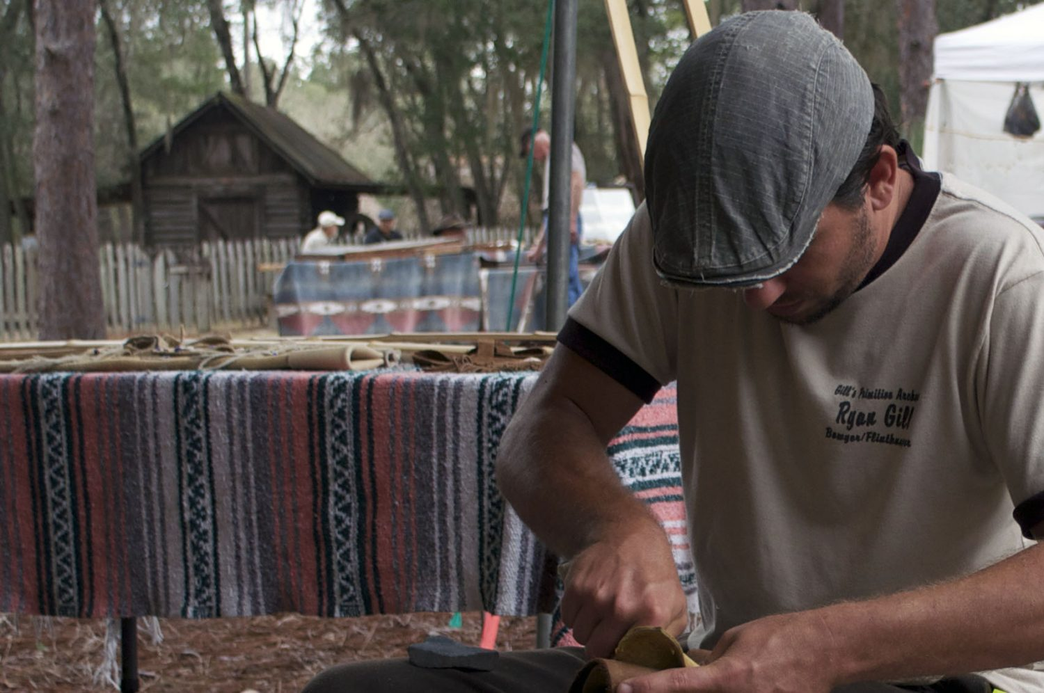 Ryan Gill, a resident of Hill Springs, Fla., demonstrated making a stone hunting point at the annual Silver River Knap-In in Ocala on Saturday. The event, which was held all weekend, featured experts in prehistoric skills who displayed and sold their crafts.