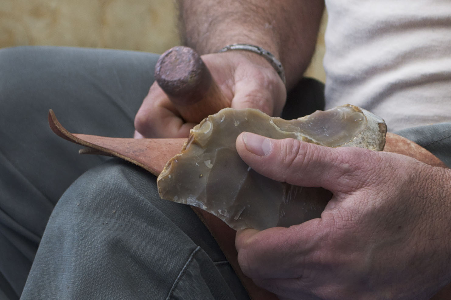 Whitfield, who began flint knapping in the early '80s, uses a tool known as a bopper, which has a copper body and a lead tip, to flake away bits of a Pedernales stone. Once finished, the arrow head will be roughly half of its total size.