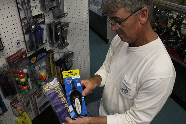 Gary Simpson, manager of Gary's Tackle Box in Gainesville, Fla., points out the venting tools he carries. His customers will longer be required to have them when fishing in Gulf of Mexico state waters since the Florida Fish and Wildlife Conservation Commission lifted the requirement on Jan. 24.