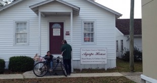 Locals wait outside the Agape House at First Baptist Church of Middleburg on Tuesday.