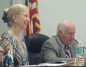 The superintendent of Putnam County's school district, Phyllis Criswell (left), and school board attorney Jim Padgett (right), sit during a school board meeting.