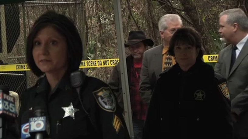 Alachua County Sheriff's Office spokeswoman Sgt. Becky Butscher speaks about the Sessions case. Alachua County Sheriff Sadie Darnell looks with Gainesville Mayor Ed Braddy (right) behind her.