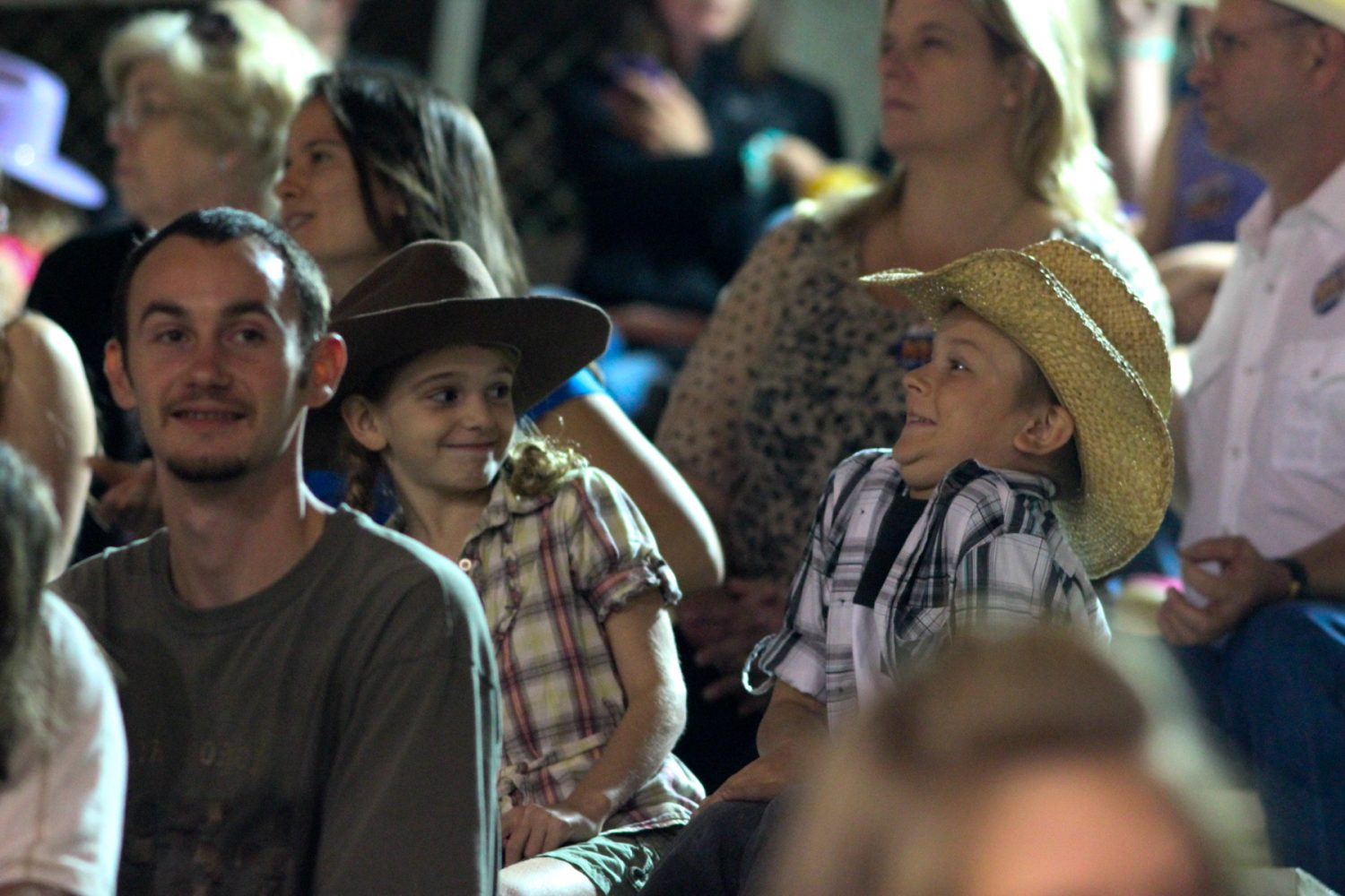 Two children make faces at one another during the intermission of the Ocala Pro Rodeo on Friday night, March 21, 2014.