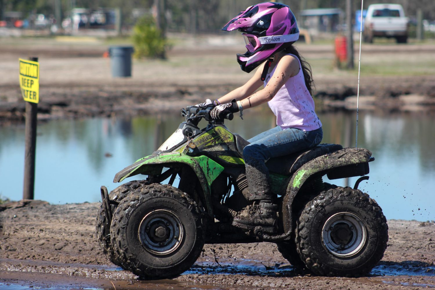 9-year-old Macy Rossiter of Greco, Fla. rides her four-wheeler through the woods on the Hog Waller property on Sunday afternoon, March 2, 2014.