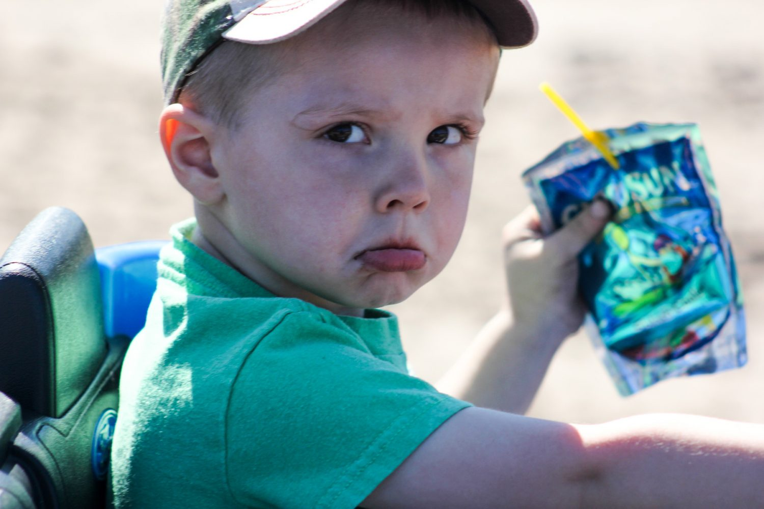 3-year-old Wayne of Meridian, Fla. pouts as he is pushed through Hog Waller on his kid-sized toy Jeep on Sunday afternoon, March 2, 2014. Wayne was upset because the batteries on his Jeep died, and he was unable to drive himself throughout the park.