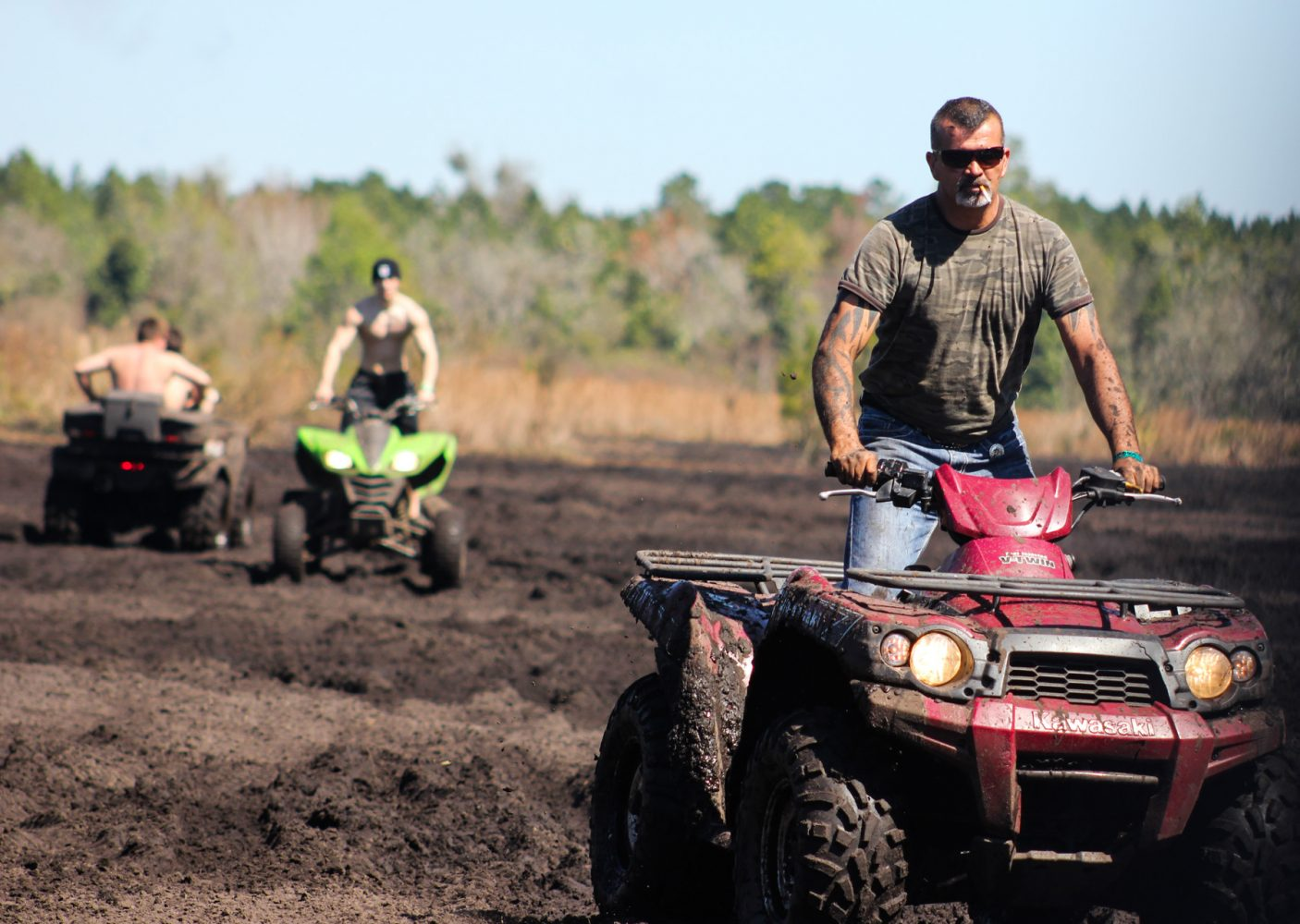 Elio Delgato rides his four-wheeler through the woods on the Hog Waller property on Sunday afternoon, March 2, 2014.