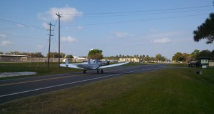 George Momberg takes off Tuesday on State Road 16 in his 1946 Ercoupe 415C plane.
