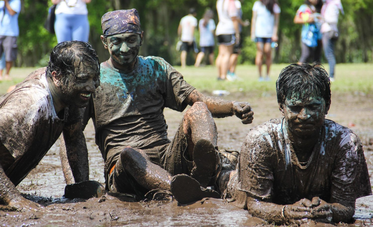 Attendees played in a mud pit at the end of the festival of colors.