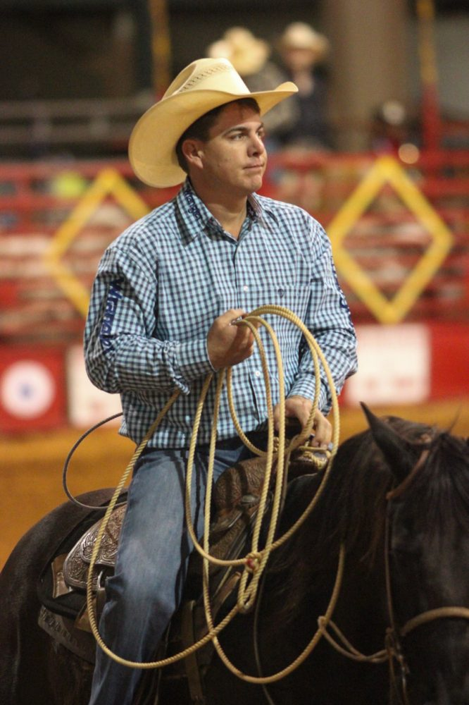 Jason Hanchey of Okeechobee, Fla. rides back to the shoots after competing in the tie down roping event at the Ocala Pro Rodeo on Saturday night, March 22, 2014.
