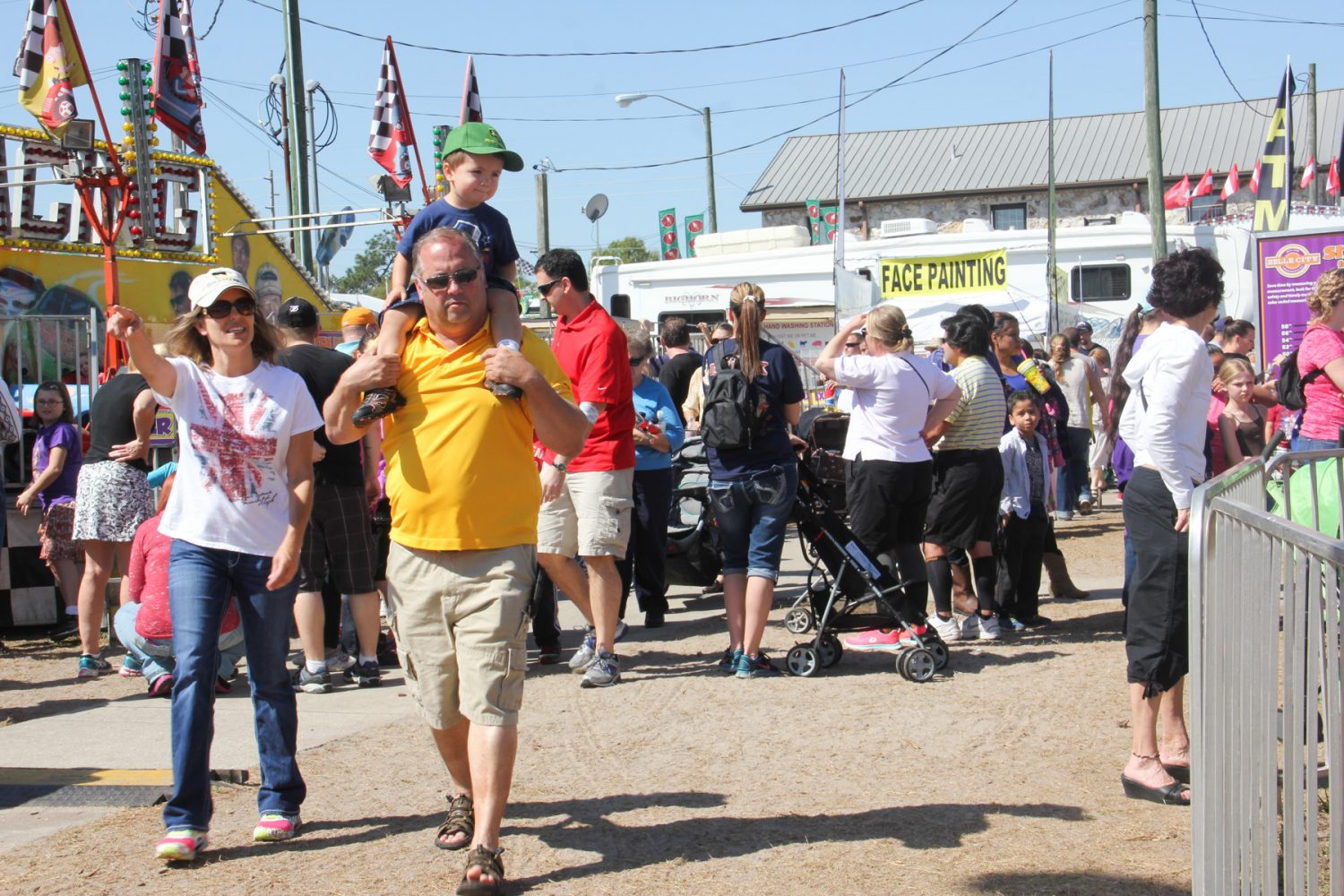 A crowd of people walk through the Florida Strawberry Festival on Sunday afternoon, Mar. 9. 2014