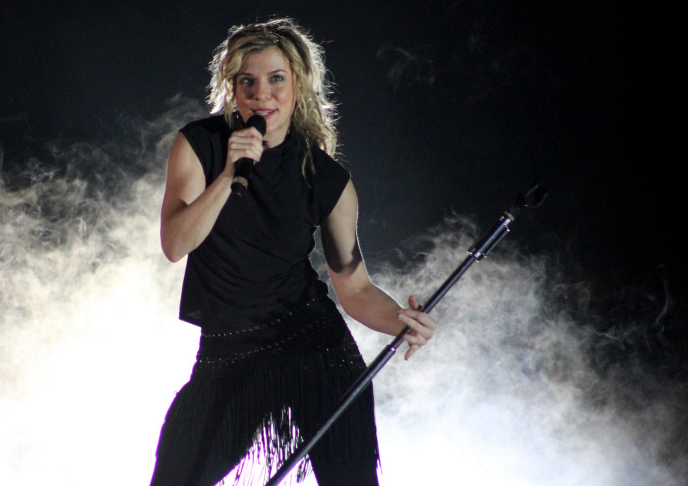 """Lead vocalist Kimberly Perry sings her hit sing, """"Better Dig Two,"""" as an encore performance at the Florida Strawberry Festival on Sunday night, Mar. 9, 2014."""