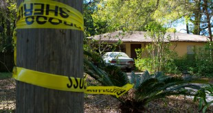 Caution tape hangs from a pole outside Joseph McGuire's home, where he fatally shot Latreese Monroe on March 26 at about 2 a.m. He resides at 15911 SW 133rd Lane in Archer, Fla.