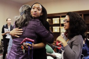 Brianna Williams, volunteer, hugs Helen Warren, candidate for City Commission At-Large seat 2, when election results revealed she's in the run-off election against Annie Orlando on April 8.