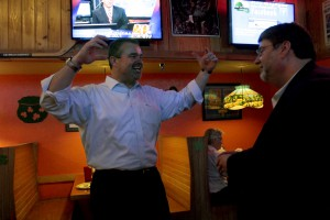Todd Chase, incumbent for City Commission District 2 seat, celebrates at Beef 'O' Brady's with supporters, family and friends.