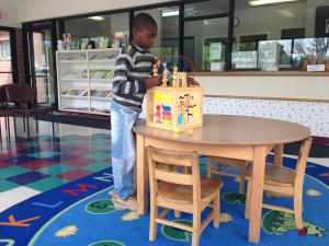 Kanye Desue, 9, plays with toys Monday morning at the The Florida Department of Health and New River Community Health Center, located at 495 E. Main St. in Lake Butler. Desue had an appointment at the center to get a refill for his ADHD medication.