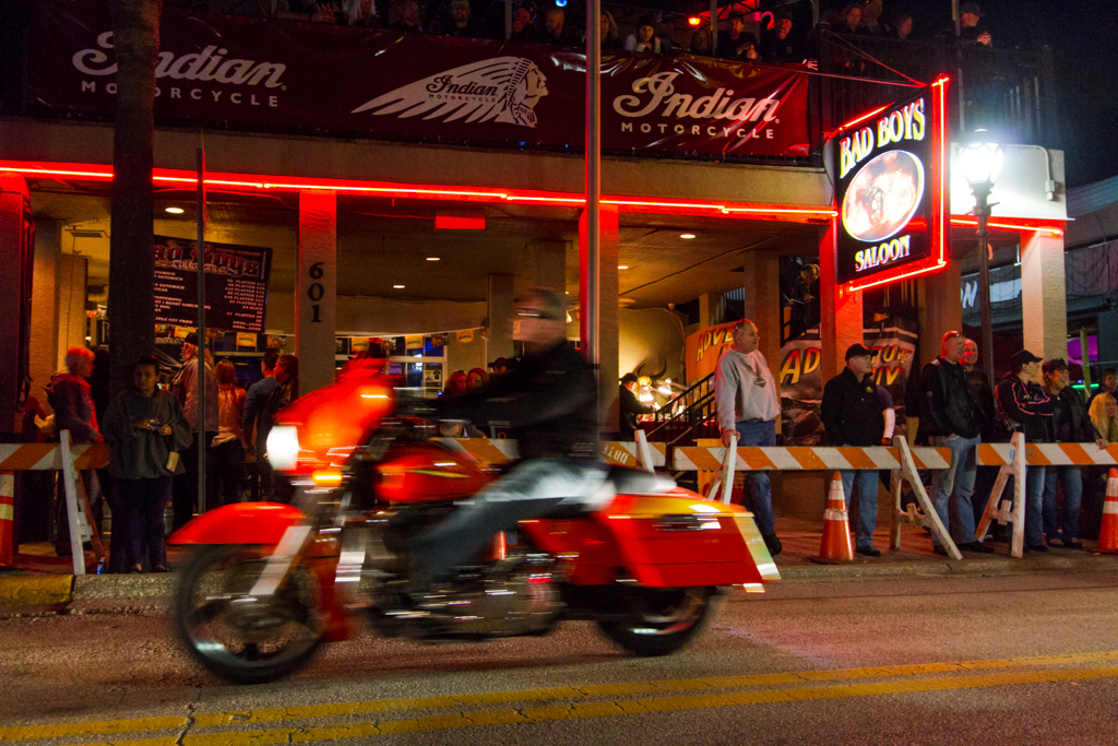 A motorcycle rides past Bad Boys Saloon during the 73rd annual Bike Week in Daytona Beach on Friday, March 14.