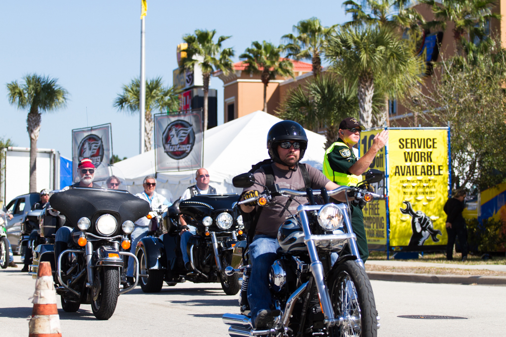 A Volusia County sherrif's deputy directs traffic while motorcycles ride by at Bruce Rossmeyer's Destination Daytona during the 73rd annual Bike Week on Saturday, March 15.