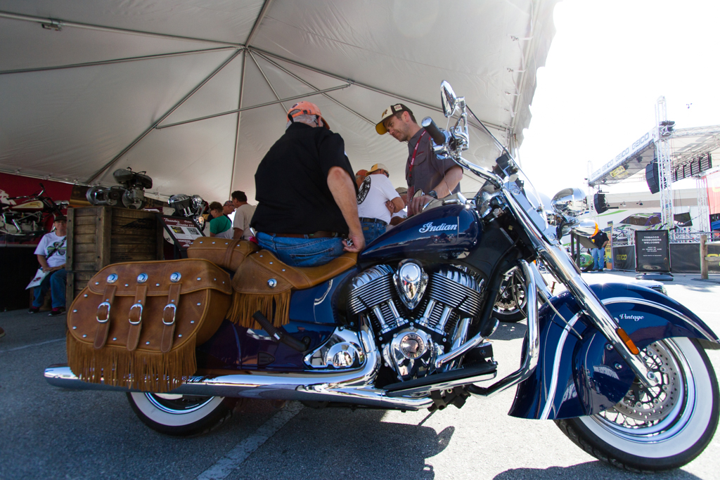 A man talks with a sales representative while sitting atop an Indian motorcycle at Bruce Rossmeyer's Destination Daytona during the 73rd annual Bike Week on Saturday, March 15.